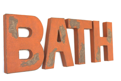 "Orange ""wooden"" bath wall letters."