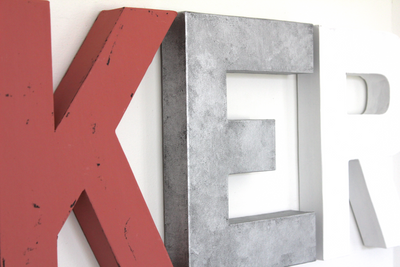 Pink letter K and silver letter E and a white letter R for girl's name wall decor.