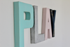 Playroom wall letters for nursery room decor in soft pastel blue's and pink's.