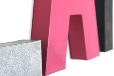"Silver ""metal"" and pink ""wooden"" letters."