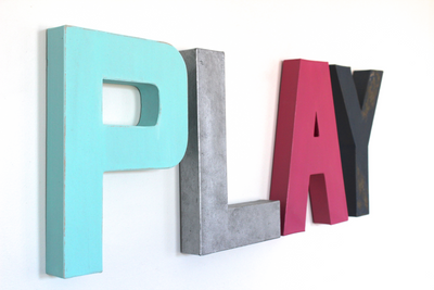 Pink and blue play sign for gender neutral playroom.