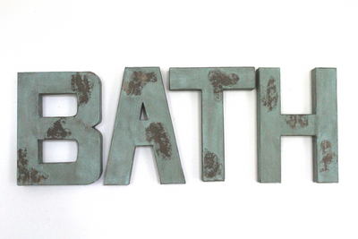 """Wooden"" bath wall letters in blue and green distressed letters."