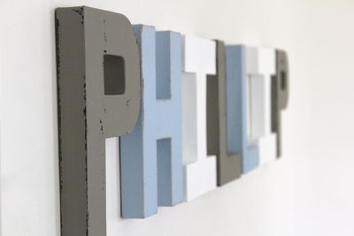 Grey and blue nursery letters spelling out Phillip.