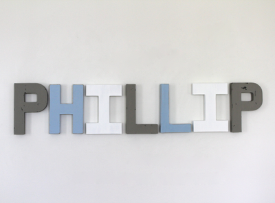 Phillip nursery wall letters in grey, blue, and white colors.