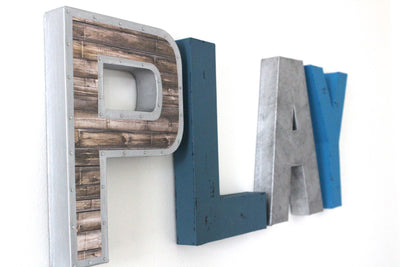 Little boy cave play wall letters in different shades of blue and silver.