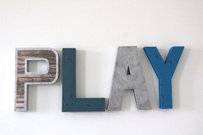 Little man play wall sign letters in shades of blue and silver.