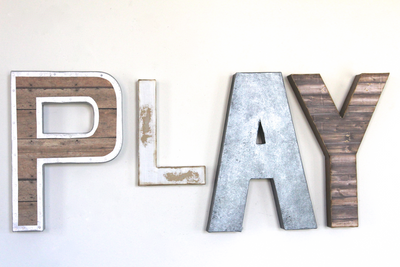 Play wall letters in brown, white, and grey.