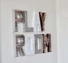 Playroom letters in browns, silvers, and white.
