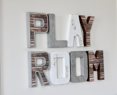 Playroom wall decor in different shades of brown, silver, and white.