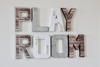 Playroom wall decor in different shades of brown, silvers, and whites for playroom wall decor.