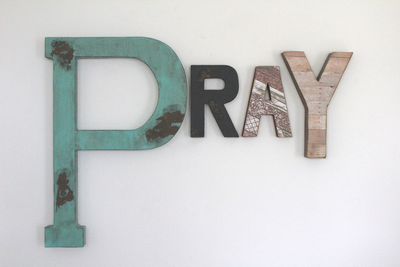 "Pray ""wooden"" wall letters in different styles and colors."