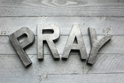 """metal"" letters with the word pray in silver"