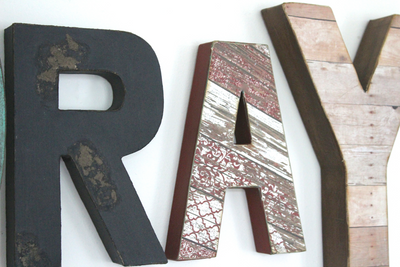 """Wooden"" wall letters in distressed black, red distressed, and a reclaimed ""wooden"" letter Y."