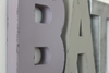 "Purple letter B and a gray ""wooden"" letter A."