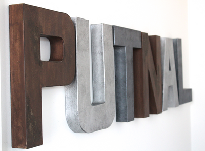 Rustic letters for kids bedroom wall decor spelling out the name Putnal in browns and silvers.