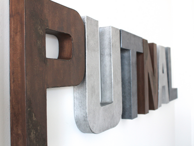 Mountain theme nursery custom wall letters spelling out the boys name Putnal in browns and silvers.