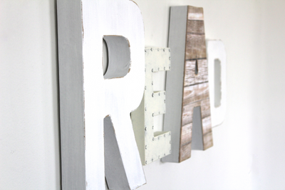 Read wall sign for playroom wall decor in rustic white letters.