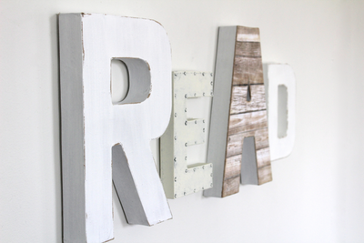 Read wall sign in white modern colors.