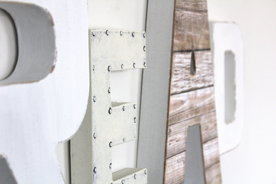 Read wall letters in different shades of distressed white for playroom decor.