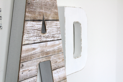 White faux reclaimed wooden letter A for modern playroom decor.