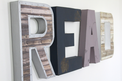 Shared space wall decor ideas with this READ sign for both girls and boys in navy and purple.