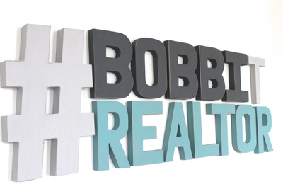#Bobbit Realtor front office wall sign.