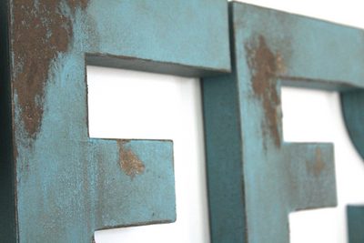 Distressed blue wall letters.