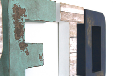 Distressed beach letters in green, navy, and white.