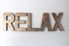 "Large bronze ""relax"" sign on the wall in ""metal"""