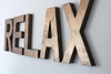 Custom RELAX bronze colored wall letters