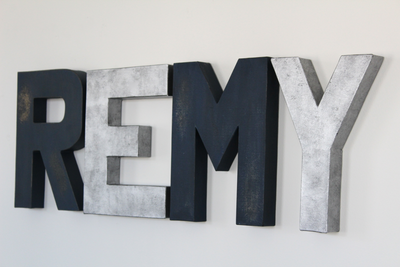 Navy and Silver Wall Letters Spelling out the Name REMY