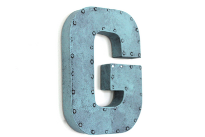 "Baby blue ""metal"" letters with a nail head trim around the letter G."
