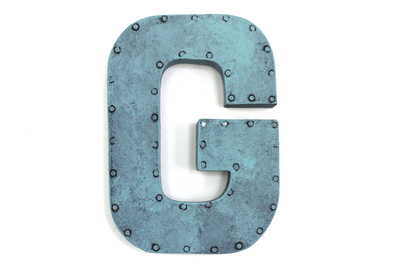 "Blue ""metal"" letter G with a nail head trim around the letter."