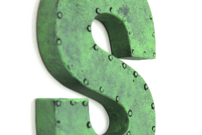"Green rusty ""metal"" letter S with a nail head trim."