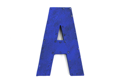 Bright electric blue letter A with a nail head trim.