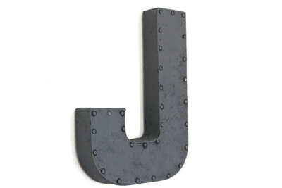 "Grey ""metal"" letter J with a nail head trim."