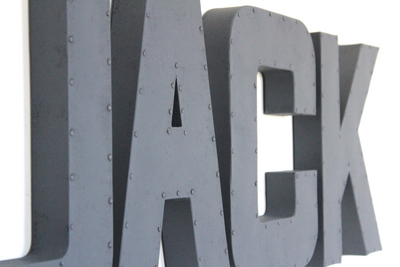 Grey wall name letters for boys aviation nursery spelling out Jack.