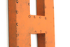 Eclectic orange wall letter H.