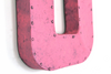 "Bright pink retro ""metal"" letter U."