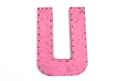 Bright pink letter U in a rustic farmhouse barn style.