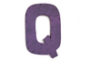 Purple letter Q with a nail head trim.