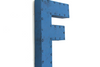 "Retro ""metal"" letter F in blue."