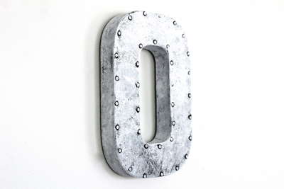 White industrial nail trim letter O.
