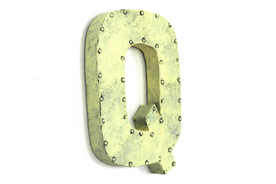 "Retro yellow ""metal"" letter Q."