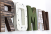 Nursery letters spelling out the name Roman in browns, green, and whites for baby nursery decor.