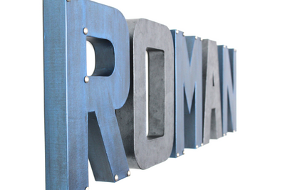 Grey and blue nursery letters spelling out the name Roman.