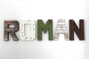 Baby nursery letters for a boys safari themed nursery spelling out a boys name Roman in different textures and neutral rustic colors.