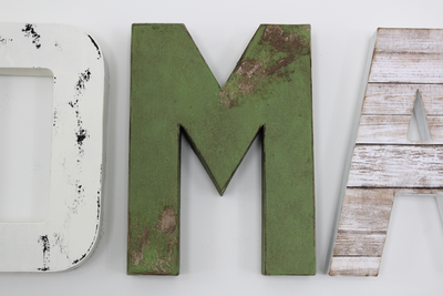 Distressed white and green nursery letters for boys safari nursery decor.