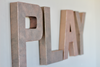 Girls playroom wall letters in rose gold faux metal.