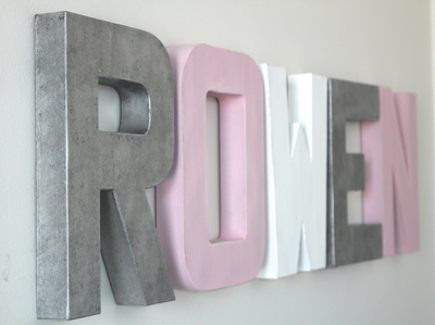 Silver, pink, and white girls name nursery name letters spelling out the name ROWEN.